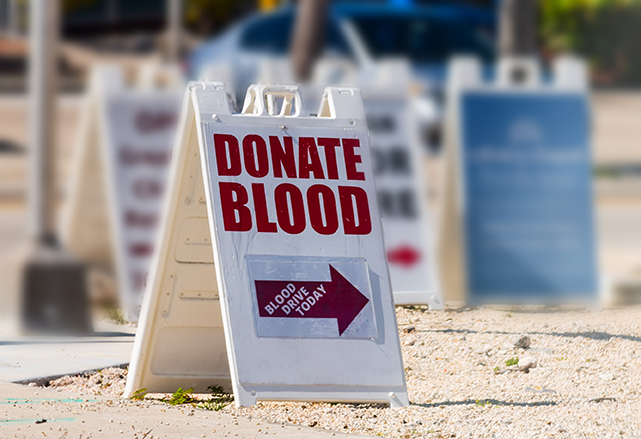 Blood drive sign asking people to donate blood.